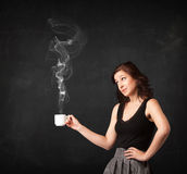 Businesswoman holding a white steamy cup Stock Image