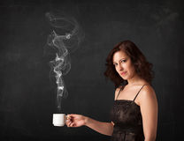 Businesswoman holding a white steamy cup Royalty Free Stock Images