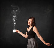 Businesswoman holding a white steamy cup Royalty Free Stock Image