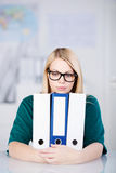 Businesswoman Holding Withe Binders At Desk Stock Images