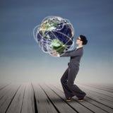 Businesswoman holding the world Stock Photo