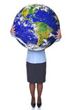 Businesswoman holding a world globe. Photo of a businesswoman holding the world in her hands, isolated on a white background Stock Images