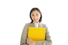 Businesswoman holding yellow folder, smiling, front view, portrait, cut out Royalty Free Stock Image