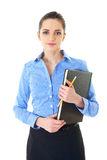 Businesswoman holds black diary, isolated Royalty Free Stock Photo