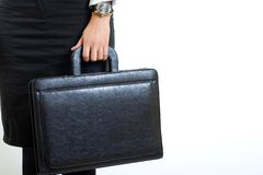 Businesswoman holds a briefcase Royalty Free Stock Photos