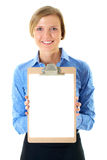 Businesswoman holds clipboard with A4 white card. Businesswoman in blue stripped shirt holds clipboard with A4 size white card, isolated on white Stock Photography