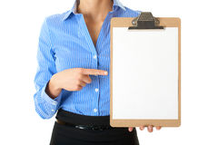Businesswoman holds clipboard and point to it Royalty Free Stock Photography