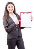Businesswoman holds clipboard and point to it Stock Photo