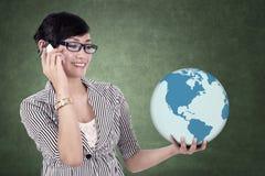 Businesswoman holds a globe Stock Photos