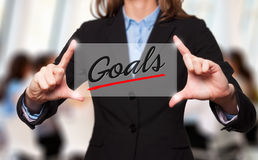Businesswoman holds Goals sign - business concept Royalty Free Stock Photo
