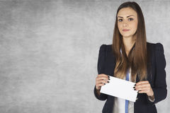 Businesswoman holds in his hands an envelope, copy space next t. Business woman holds in his hands an envelope, copy space next to Stock Images