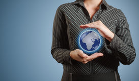 Businesswoman holds or holding world earth in hand Royalty Free Stock Photos