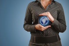 Businesswoman holds or holding world earth in hand Royalty Free Stock Photography