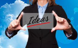 Businesswoman holds ideas sign - business concept Royalty Free Stock Images