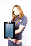 Businesswoman holds ipad like device Royalty Free Stock Images