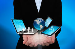 Businesswoman holds laptop, phone, tablet, globe in hands - Stock Image Stock Photo