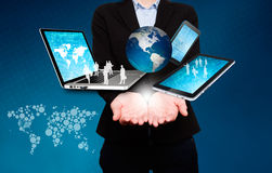 Businesswoman holds laptop, phone, tablet, globe in hands - Stock Image Stock Image