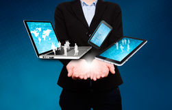 Businesswoman holds laptop, phone, tablet, in hands - Stock Image Royalty Free Stock Photography