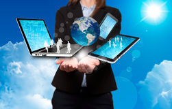 Businesswoman holds modern technology in hands - Stock Image Royalty Free Stock Images
