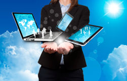 Businesswoman holds modern technology in hands - Stock Image Stock Image