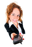 Businesswoman holds out a mobile phone. Royalty Free Stock Photography