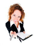 Businesswoman holds out a pen Stock Photography