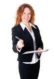 Businesswoman holds out a pen Royalty Free Stock Photo