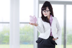 Businesswoman holds piggy bank for savings 1 Royalty Free Stock Image