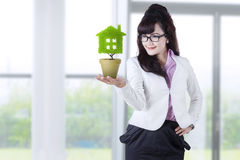 Businesswoman holds plant in pot 1 Stock Image