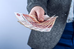 Businesswoman holds Russian rubles. Royalty Free Stock Photo