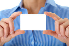 Businesswoman holds white card, isolated on white Stock Photography