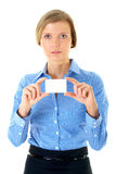 Businesswoman holds white card, isolated on white Stock Photos