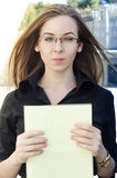 Businesswoman holds a yellow folder with paper Stock Photography
