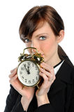 Businesswoman Holfing Alarm Clock Royalty Free Stock Images