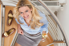 Businesswoman at home with champagne Stock Images
