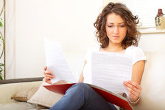 Businesswoman at home doing paperwork stock image