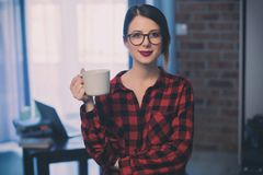 Businesswoman at home interior with cup of coffee. Royalty Free Stock Photos