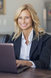 Businesswoman At Home Office Using Laptop Royalty Free Stock Image