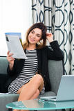 Businesswoman in hotel reading a journal Royalty Free Stock Photo