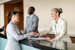 Businesswoman at hotel reception royalty free stock photo