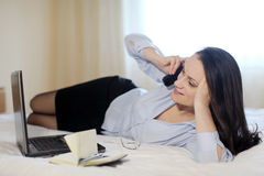 A businesswoman in a hotel room stock photo