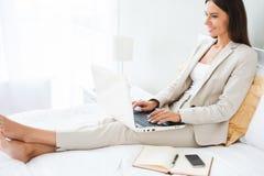 Businesswoman in hotel room. Stock Image