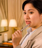 Businesswoman In A Hotel Thinking Royalty Free Stock Photography