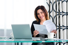 Businesswoman in hotel working with agreement Royalty Free Stock Images