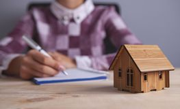 Businesswoman house documents to sign stock photography