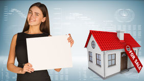 Businesswoman and house with label for the sale Stock Photography