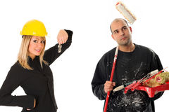 Businesswoman and house painter Royalty Free Stock Image