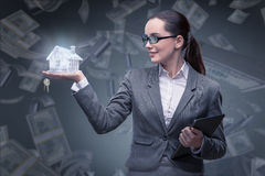 The businesswoman in housing mortgage concept Royalty Free Stock Images