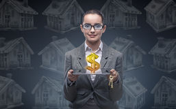 The businesswoman in housing mortgage concept Stock Photography