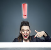 Businesswoman with a huge excalamation mark Stock Image